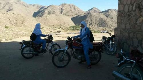 girls-riding-bike-to-school-in-jaghuri-hazarajat-500px